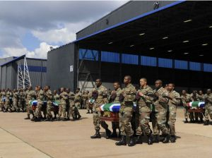 Members of the SANDF carry the mortal remains of 13 members that were killed in Central African Republic (CAR) during the handing over to the respective families at the Waterkloof Air Force Base, in Pretoria, March 28 (Reuters)